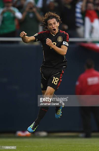 Andres Guardado of Mexico leaps in the air in celebration after scoring against Costa Rica during a CONCACAF Gold Cup 2011 match at Soldier Field on...