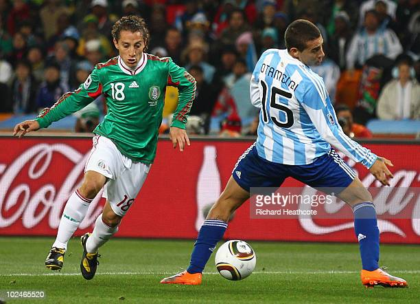 Andres Guardado of Mexico moves past Nicolas Otamendi of Argentina during the 2010 FIFA World Cup South Africa Round of Sixteen match between...