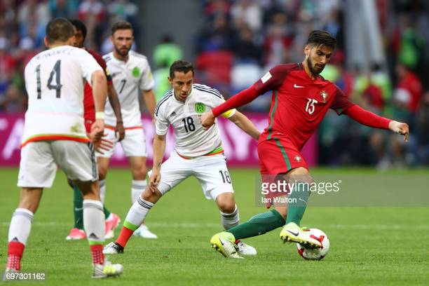 Andres Guardado of Mexico puts pressure on Andre Gomes of Portugal during the FIFA Confederations Cup Russia 2017 Group A match between Portugal and...