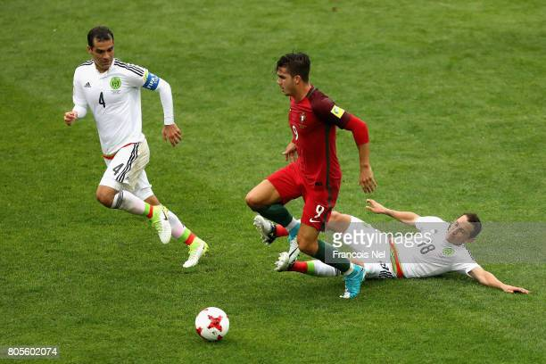 Andres Guardado of Mexico tackles Andre Silva of Portugal during the FIFA Confederations Cup Russia 2017 PlayOff for Third Place between Portugal and...