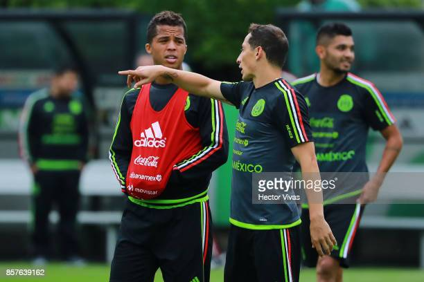 Andres Guardado of Mexico talks with teammate Giovani Dos Santos during a Mexico's National Team training session ahead of the Qualifier match...