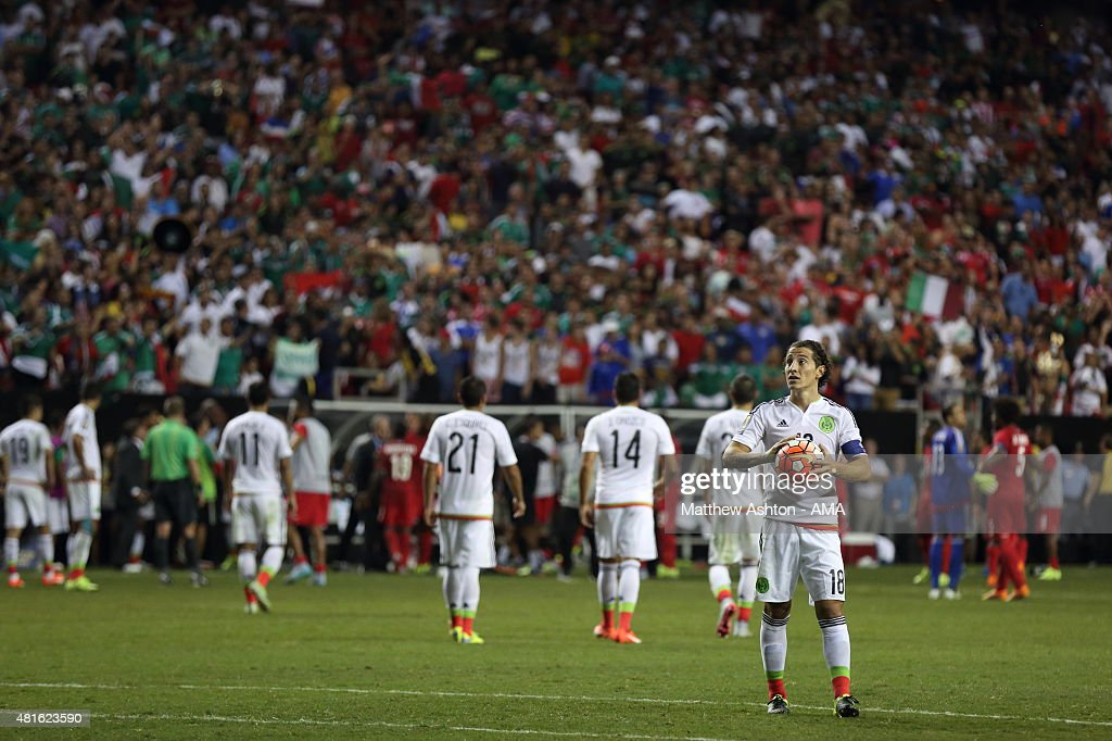 Andres Guardado of Mexico waits to take his penalty kick as Panama players walk off the field in protest after a last minute penalty was awarded in the last minute of the 2015 CONCACAF Gold Cup Semi Final between Panama and Mexico at Georgia Dome on July 22, 2015 in Atlanta, Georgia.