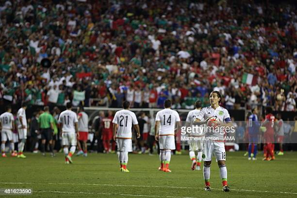 Andres Guardado of Mexico waits to take his penalty kick as Panama players walk off the field in protest after a last minute penalty was awarded in...