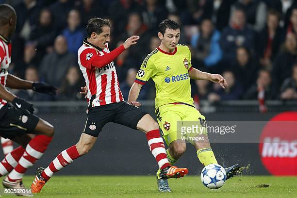 Andres Guardado of PSV Alan Dzagoev of CSKA Moscow during the UEFA Champions League match between PSV Eindhoven and CSKA Moscow on December 8 2015 at...