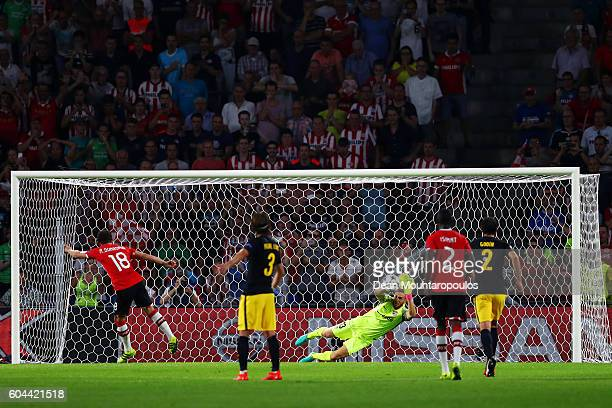 Andres Guardado of PSV Eindhoven takes a penalty which is saved by Jan Oblak of Atletico Madrid during the UEFA Champions League Group D match...