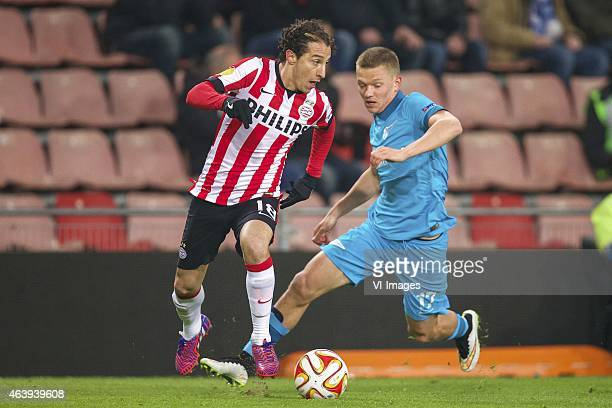 Andres Guardado of PSV Oleg Shatov of FC Zenit during the round of 32 UEFA Europa League match between PSV Eindhoven and Zenit Saint Petersburg on...