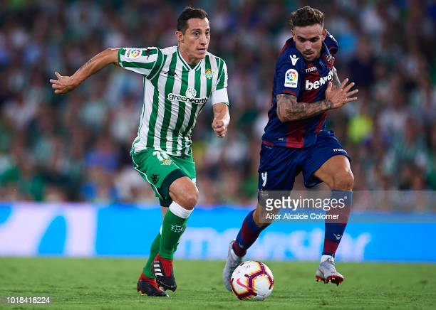 Andres Guardado of Real Betis Balompie being followed by Roger Marti of Levante UD during the La Liga match between Real Betis Balompie and Levante...