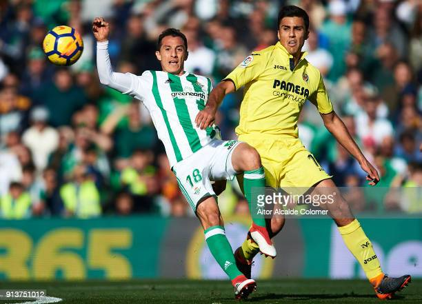 Andres Guardado of Real Betis Balompie competes for the ball with Rodrigo Hernandez of Villarreal CF during the La Liga match between Real Betis and...