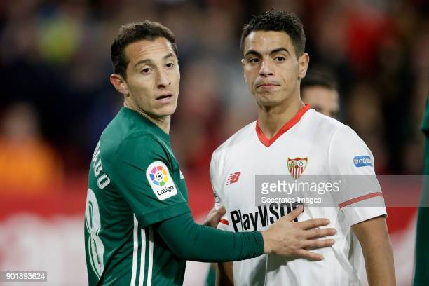 Andres Guardado of Real Betis Wissam Ben Yedder of Sevilla FC during the La Liga Santander match between Sevilla v Real Betis Sevilla at the Estadio...