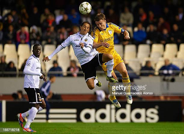 Andres Guardado of Valencia duels for the ball with Vitali Rodionov of BATE Borisov during the UEFA Champions League group F match between Valencia...