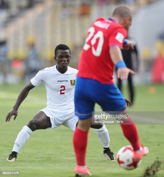 Andres Hernandez of Costa Rica is challenged by Samuel Conte of Guinea during the FIFA U17 World Cup India 2017 group C match between Costa Rica and...