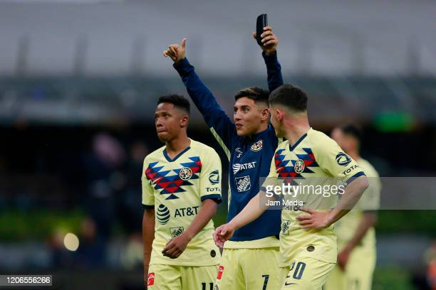 Andres Ibarguen Leonardo Suarez and Richard Sanchez of America celebrate after the 6th round match between America and Atlas as part of the Torneo...