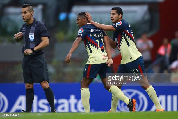 Andres Ibarguen of America celebrates with teammate Cecilio Dominguez after scoring the fourth goal of his team during the match between America and...