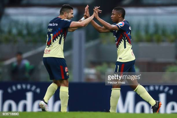 Andres Ibarguen of America celebrates with teammate Henry Martin after scoring the fourth goal of his team during the match between America and Tauro...