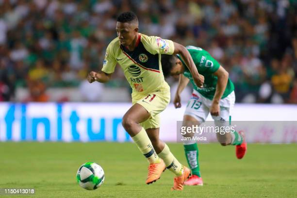Andres Ibarguen of America fights for the ball with Angel Mena of Leon during the semifinals second leg match between Leon and America as part of the...
