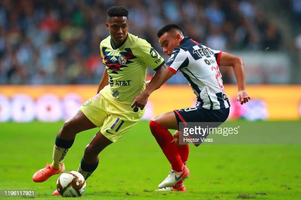 Andres Ibarguen of America fights for the ball with Carlos Rodriguez of Monterrey during the Final first leg match between Monterrey and America as...
