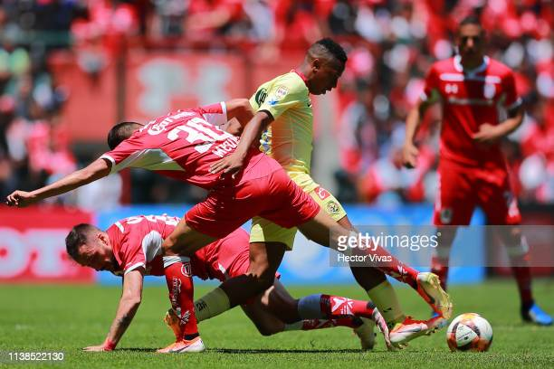 Andres Ibarguen of America struggles for the ball with Alan Medina and Federico Mancuello of Toluca during the 15th round match between Toluca and...