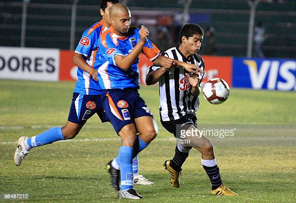 Andres Imperiale of Bolivia's Blooming vies for the ball with Vicente Gamarra of Paraguayan Libertad on April 15 during a Libertadores Cup football...