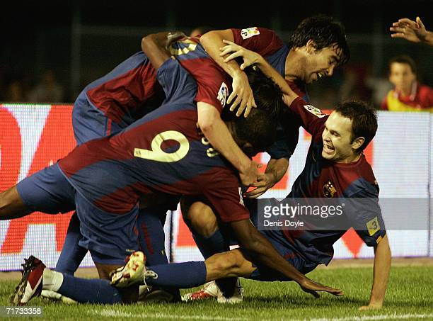 Andres Inesta of Barcelona celebrates with teammates after Lionel Messi scored his team's second goal against Celta de Vigo during the Primera Liga...