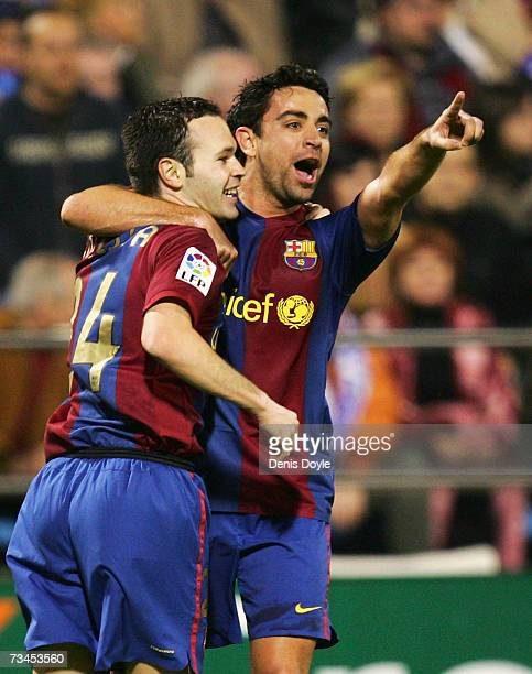 Andres Inesta of Barcelona celebrates with Xavi after scoring his team`s second goal against Real Zaragoza during the Kings Cup quarterfinal 2nd leg...