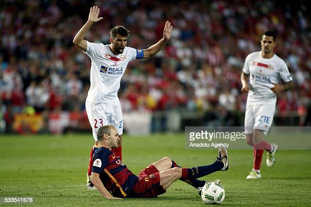 Andres Inesta of Barcelona in action againstCoke of Sevilla during the Copa del Rey Final match between FC Barcelona and Sevilla FC at Vicente...