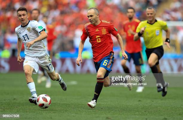Andres Inesta of Spain and Roman Zobnin of Russia in action during the 2018 FIFA World Cup Russia Round of 16 match between Spain and Russia at...