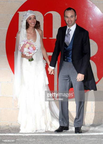 Andres Iniesta and Ana Ortiz pose for photographers at their wedding reception on July 8 2012 in Tarragona Spain