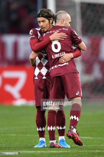 Andres Iniesta and Hotaru Yamaguchi of Vissel Kobe hug during the 99th Emperor's Cup final between Vissel Kobe and Kashima Antlers at the National...