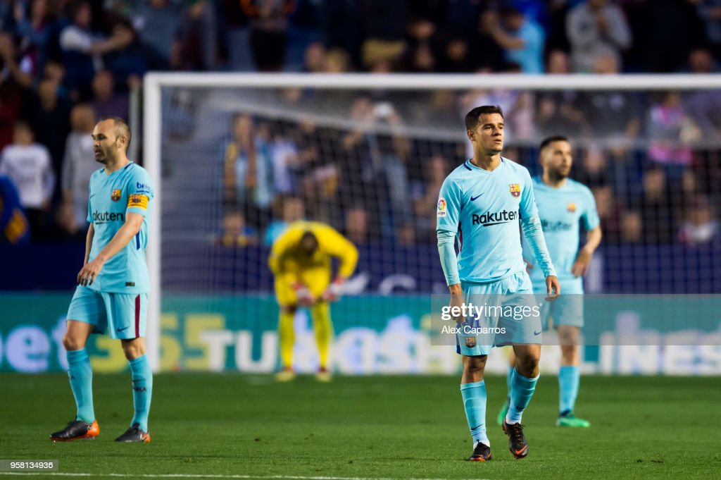 Andres Iniesta and Philippe Coutinho of FC Barcelona react after Emmanuel Boateng of Levante UD scored his team's second goal during the La Liga match between Levante UD and FC Barcelona at Estadi Ciutat de Valencia on May 13, 2018 in Valencia, Spain.