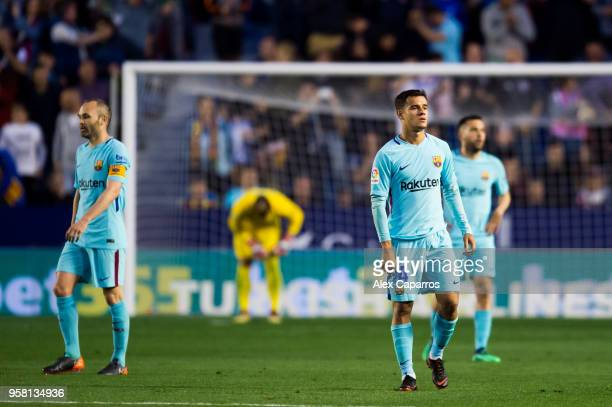 Andres Iniesta and Philippe Coutinho of FC Barcelona react after Emmanuel Boateng of Levante UD scored his team's second goal during the La Liga...