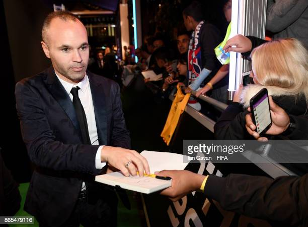 Andres Iniesta arrives and writes autographs on the green carpet for The Best FIFA Football Awards at The London Palladium on October 23 2017 in...