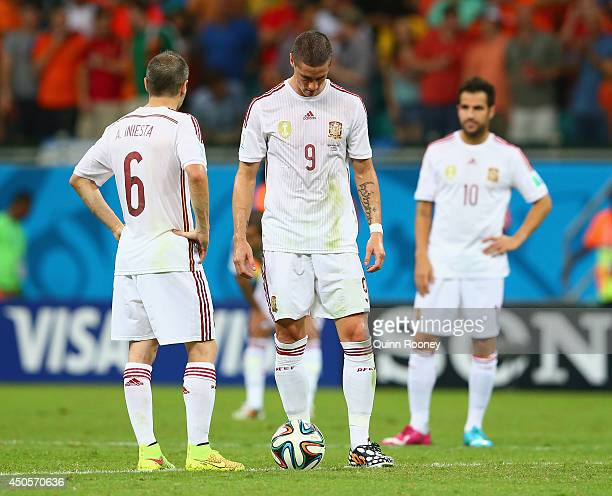 Andres Iniesta Fernando Torres and Cesc Fabregas of Spain look dejected pduring the 2014 FIFA World Cup Brazil Group B match between Spain and...
