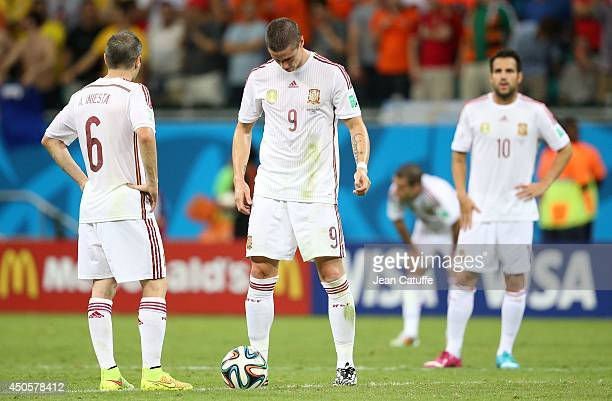 Andres Iniesta Fernando Torres and Cesc Fabregas of Spain look dejected during the 2014 FIFA World Cup Brazil Group B match between Spain and...