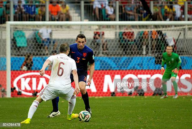 Andres Iniesta from Spain faces De Vrij from Netherlands both watched by Netherlands' goalkeeper Jasper Cillessenc at the 2014 World Cup match...
