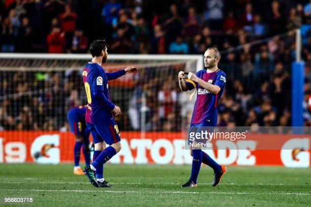 Andres Iniesta from Spain of FC Barcelona giving to 10 Leo Messi from Argentina of FC Barcelona the captain bracelet during the La Liga football...