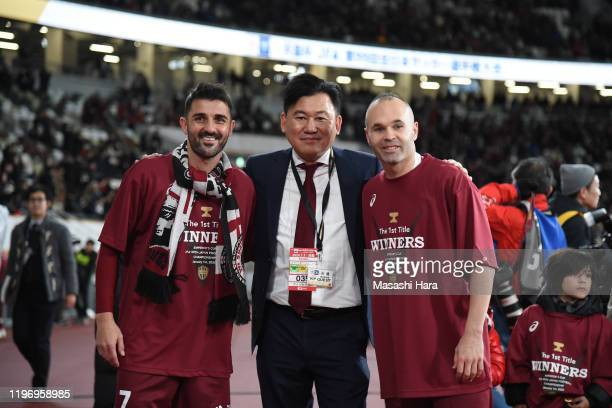 Andres Iniesta, Hiroshi Mikitani and David Villa of Vissel Kobe pose for photographs after the 99th Emperor's Cup final between Vissel Kobe and...