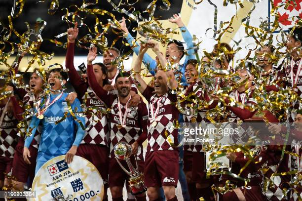 Andres Iniesta holds the trophy aloft during the trophy presentation of the 99th Emperor's Cup final between Vissel Kobe and Kashima Antlers at the...