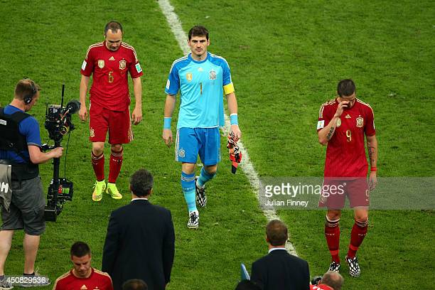 Andres Iniesta Iker Casillas and Fernando Torres of Spain look dejected as they walk off the pitch after a 20 defeat to Chile in the 2014 FIFA World...