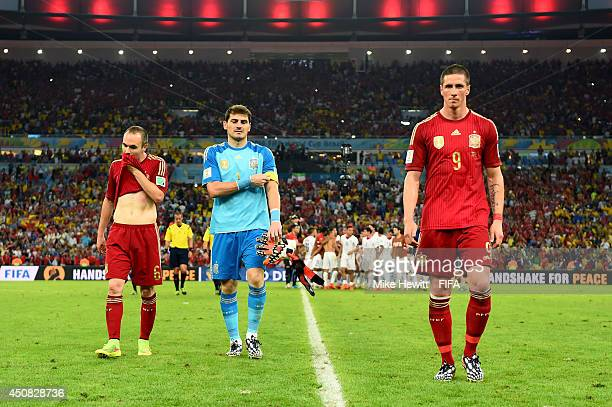 Andres Iniesta Iker Casillas and Fernando Torres of Spain walk off the pitch after the 2014 FIFA World Cup Brazil Group B match between Spain and...