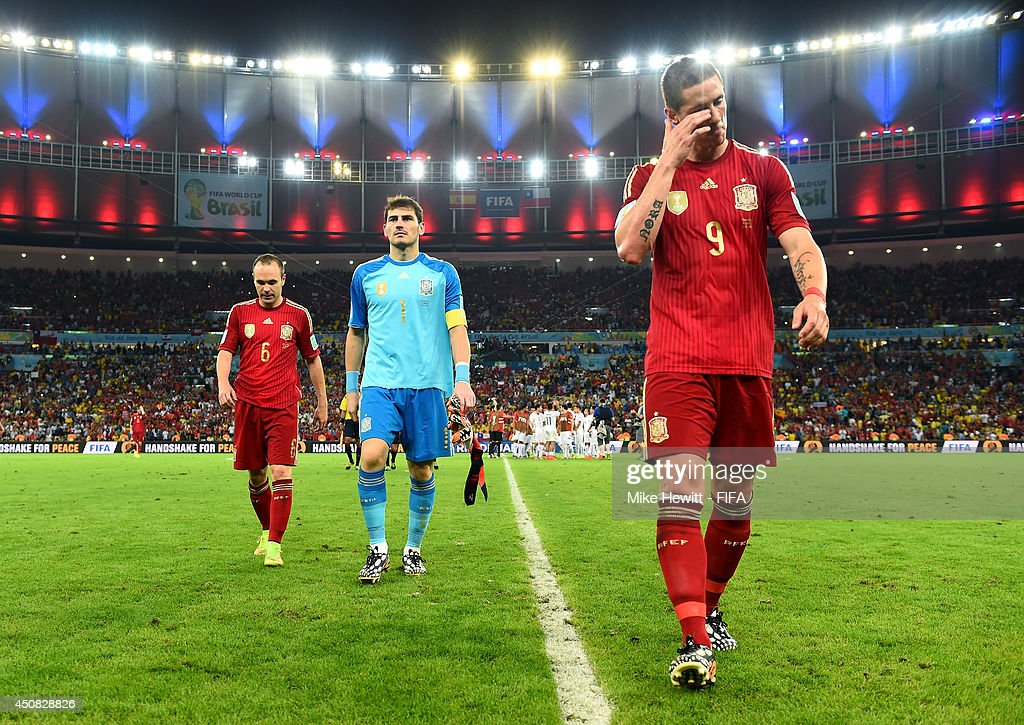 Andres Iniesta, Iker Casillas and Fernando Torres of Spain walk off the pitch after the 2014 FIFA World Cup Brazil Group B match between Spain and Chile at Estadio Maracana on June 18, 2014 in Rio de Janeiro, Brazil.