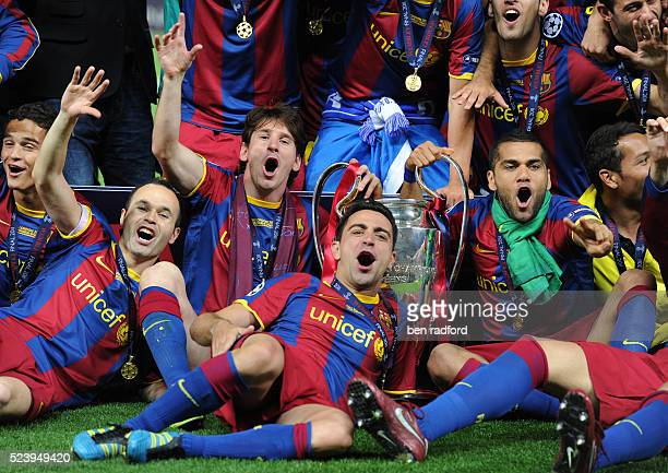 Andres Iniesta Lionel Messi Xavi Hernandez and Danny Alves of Barcelona celebrate winning the 2011 UEFA Champions League Final between Barcelona and...