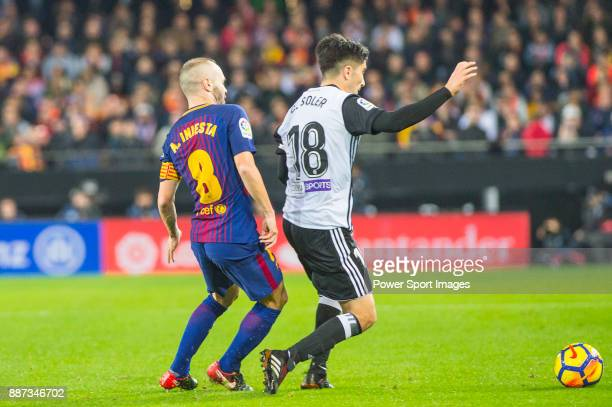 Andres Iniesta Lujan of FC Barcelona competes for the ball with Carlos Soler Barragan of Valencia CF during the La Liga 201718 match between Valencia...