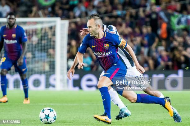 Andres Iniesta Lujan of FC Barcelona is tackled by Rodrigo Bentancur of Juventus during the UEFA Champions League 2017-18 match between FC Barcelona...