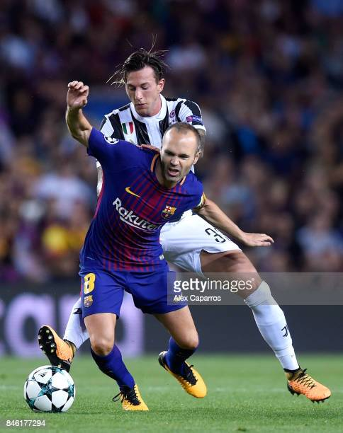 Andres Iniesta of Barcelona and Federico Bernardeschi of Juventus battle for possession during the UEFA Champions League Group D match between FC...