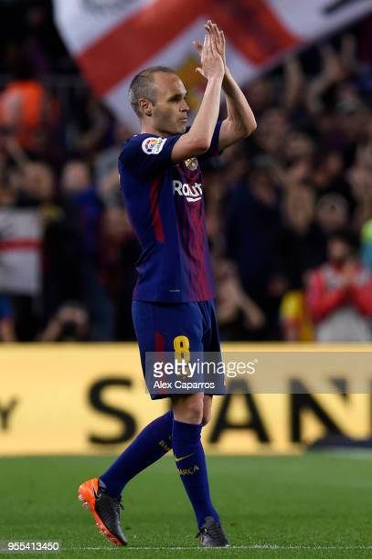 Andres Iniesta of Barcelona applauds the crowd as he is substituted in his final El Clasico during the La Liga match between Barcelona and Real...