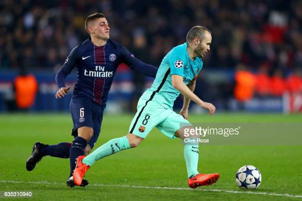 Andres Iniesta of Barcelona battles for the ball with Marco Verratti of Paris SaintGermain during the UEFA Champions League Round of 16 first leg...