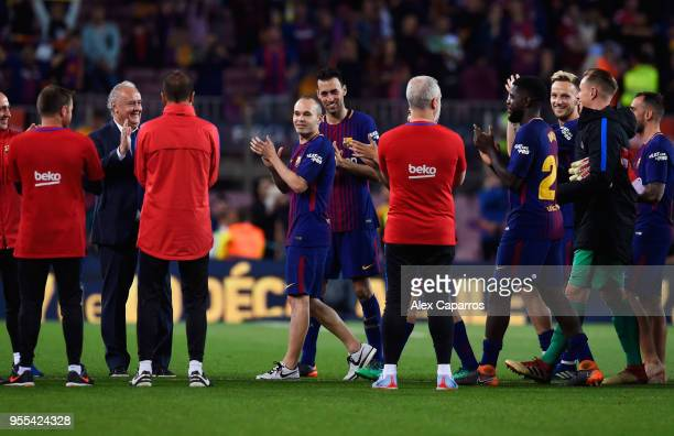 Andres Iniesta of Barcelona ceebrates with team mates after the La Liga match between Barcelona and Real Madrid at Camp Nou on May 6 2018 in...