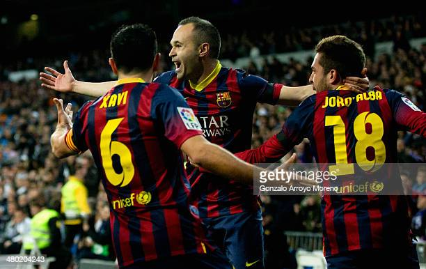 Andres Iniesta of Barcelona celebrates scoring the opening goal with team mates during the La Liga match between Real Madrid CF and FC Barcelona at...