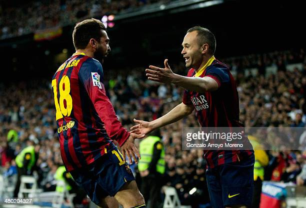 Andres Iniesta of Barcelona celebrates scoring the opening goal with Jordi Alba of Barcelona during the La Liga match between Real Madrid CF and FC...