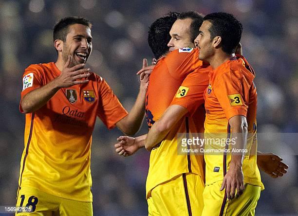 Andres Iniesta of Barcelona celebrates scoring with his teammate Pedro Rodriguez Jordi Alba and Xavi Hernandez during the la Liga match between...